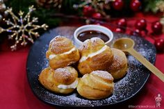 "This is one of my all-time favorite dessert to bring to Christmas parties. I fell in love with Profiteroles when I tried them in Italy a decade ago. Profiteroles are basically cream puffs or as the French would say ""choux à la crème (shoo ah lah krem) filled with either whipped cream, custard, ice cream, drizzled with warm chocolate sauce on top..."
