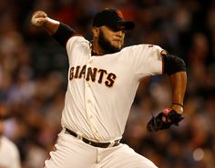 San Francisco Giants starting pitcher Yusmeiro Petit (52) throws against the San Diego Padres in the first inning at AT&T Park in San Francisco, Calif., on Thursday, Sept. 25, 2014.  (Nhat V. Meyer/Bay Area News Group)