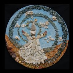 """FAT(T)A DI PIETRA"" (2012)  ARTIST: Cécile Dossogne TECHNIQUE: Manufacture with stones, stucco and seashells on plywood colored with acrylics.  SIZE: Diameter 22.85''. Depth 1.18'' Fairy, circular, natural."