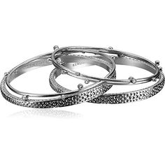 Kendra Scott Tatum Rhodium-Plated Multi Bangle Bracelets This Kendra Scott rhodium-plated multi bangle bracelet part of Tatum collection is sure to compliment her personal style. Featuring stacked bangles with textured finish with bezel-set cubic zirconia stones its super trendy to wear. This fashionable bangle bracelet will make a perfect addition to her jewelry box. Made in a modern design that women of all ages and tastes can wear. This Kendra Scott Tatum rhodium-plated multi bangle…