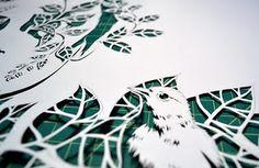 Dreamlike elaborate paper-cut art.
