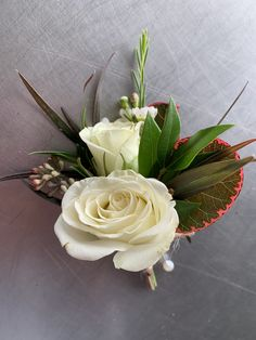 Loved it! Pinned it! A Blooming Envy Design! Designed with White Spray Roses, Eucalyptus and Smoke Bush.