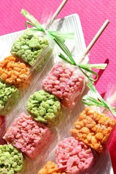 rice krispie treats on skewers (cute party idea)  (could I do this with the popcorn bags so they could stand up?? Maybe have them layer popcorn colors?)