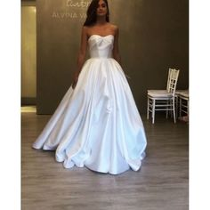Honor Alabaster tulle fit to flare bridal gown, elongated bodice with floral sequin pattern and hologram accent, V-neckline and modern keyhole back, tiered tulle skirt.