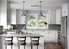 Elegant kitchen of lakeside retreat in gray and white [From: David Coulson Design]