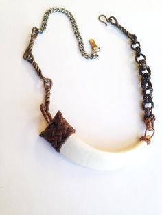 Repurposed from a vintage necklace, this one of a kind massive tooth necklace (boar