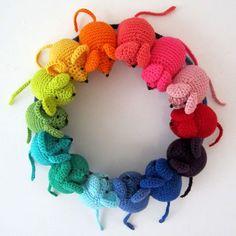 A wreath of crochet rainbow mice