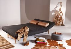 I like the detail with the head rest - Aslak Sofa Bed, oak - from Innovation Living