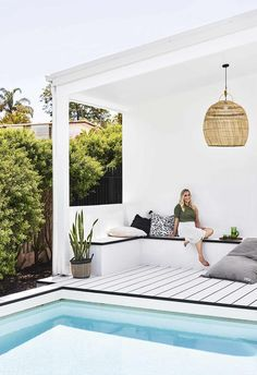 Made in the shade: Poolside relaxing is a breeze for homeowner Hannah, with slouchy linens, coastal weaves and crisp white HardieDeck.