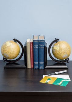 Meet Your Map Bookends. Some of your most treasured adventures are the ones youve imagined while immersed in a novel from your growing collection. #gold #prom #modcloth