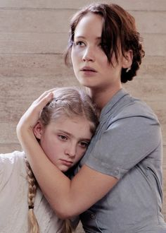 Tone Image: Although this is a sisters relationship, Katniss takes over the parental role for Prim just like Jason is the adult figure for June