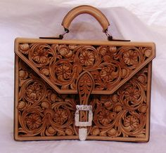 Andy Stevens Saddlery : Custom Leather Accessories beautiful purses!