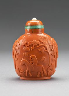 Snuff Bottle, with carved depiction of a monkey on a horse, 1750 - 1820 Chinese, Imperial Palace Workshops of Beijing, mid-18th to early 19th century Snuff Bottle, coral, green tourmaline, moonstone, ivory, 8.7 x 6.5 x 5.7 cm The Thomson Collection ©...
