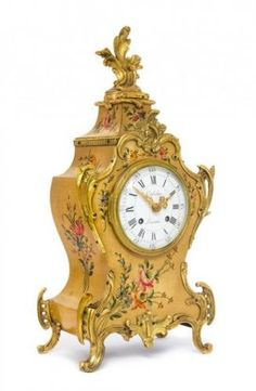 A Louis XV Style Gilt Bronze Mounted Painted Mantel Clock Height 14 inches. - Price Estimate: $200 - $400