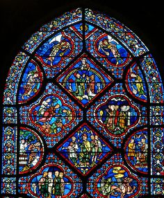 This early 13th century window depicts the story of Noah, and was donated to the Cathedral of Chartres by the town's carpenters, wheelwrights, and coopers.    http://professor-moriarty.com/info/en/section/stained-glass/pre-c19/chartres-cathedral-noah-window