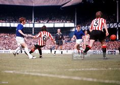 21st August Everton 0 v Sheffield United 1 Alan Ball and Joe Royle take on the United defence as...