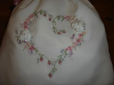 Some ribbon embroidery and surface stitchery I made on a lingerie bag.