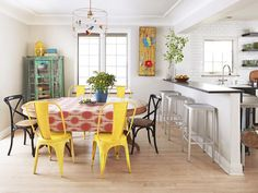 Mix-and-match chairs in this dining area make things fun. #hgtvmagazine http://www.hgtv.com/kitchens/a-kitchen-with-personality/pictures/page-2.html?soc=pinterest