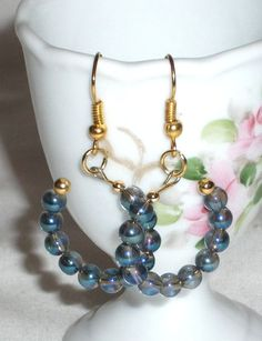 Earrings open circle with chinese rainbow blue by Momentidoro, €17.00