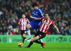 John O'Shea of Sunderland challenges Diego Costa of Chelsea during the Barclays Premier League match between Sunderland and Chelsea at Stadium of Light on November 29, 2014 in Sunderland, England.