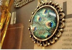 I can't tell if it's a peacock brooch or picture wall art but I can tell its sooo pretty!!!