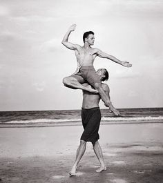 Mikhail Baryshnikov being lifted by another man. Sadly, the other dancer isn't named at the link. (Photo by Annie Liebovitz.)