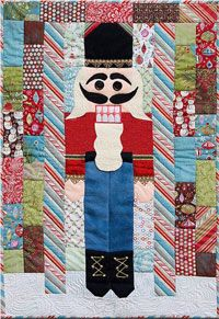 A holiday favorite, this trustworthy nutcracker stands guard between the peppermint pillars at the Land of Sweets. Simple embellishments add to the unique charm of this seasonal wall hanging. The quilt can be made easily with a holiday charm pack and a few small pieces of wool and trims. http://www.kayewood.com/Nutcracker-Sweet-Quilt-Pattern-by-Little-House-Quilts-LHQ-NUSW.htm $9.50