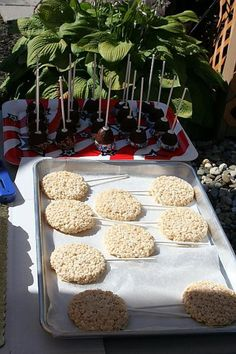 Rice Krispy treats and decorate as baseballs with red stitching