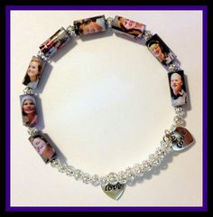 I made this from a group photo Single strips of paper rolled and sealed. Great keepsake! - by: Laurindalee's Paper Bead Jewelry - Linda Myers Miller Patrick