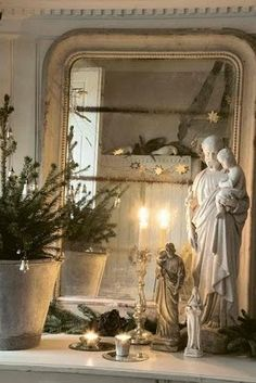 Lovely home altar featuring shabby St. Joseph figurines.  Nice :)