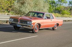Reliving His Youth Behind the Wheel of a Rare Sunfire Red 1964 Pontiac GTO - Hot Rod Classic Car Garage, Classic Cars, Dream Car Garage, Pontiac Cars, Lifted Ford Trucks, Us Cars, Koenigsegg, Bugatti Veyron, Car Wrap