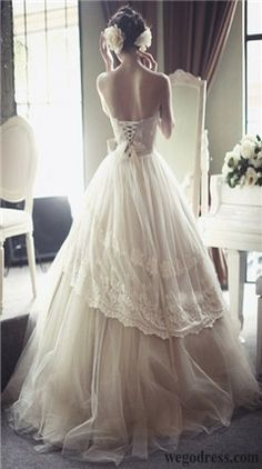 The lace up back and the layers of the skirt. wedding dress wedding dresses