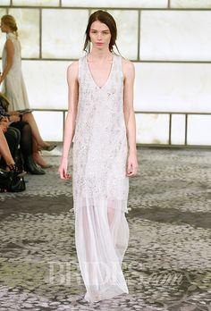 "Brides.com: . Trend: Sheer Skirts. ""Simone"" sleeveless crystal-embroidered sheath wedding dress with a v-neckline and sheer skirt, Rivini"