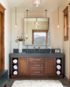 Lights...love the lights! Also the wood tone with the dark chunky cabinet top.