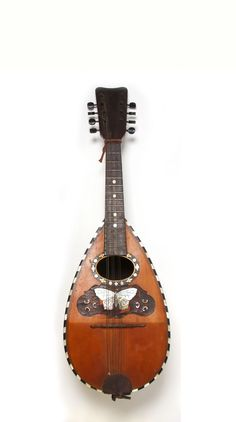 Learn to play an instrument… like the mandolin, perfect for small hands.