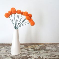 Orange Felt flowers. Wool Pom pom Flowers. Faux Flower Bouquet. Small Floral Arrangement. Fake Centerpiece. Craspedia Table Decoration. Beautiful new shade of mango orange wool make up these sweet little blooms. You can use them on their own as a bouquet or add them as an accent to another arrangement. These sweet pom pom flowers are a little less time-consuming than my usual bouquets. With this particular line they are a bit loosely felted, very fuzzy and free form. I've needle felted…