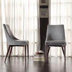 The Sasha collection features gracefully shallow side wings and slope legs, adding elegance to the clean lines of this dining accent chair. The chair is upholstered in grey fabric and designed with a deep seat, to offer unparalleled comfort and style.