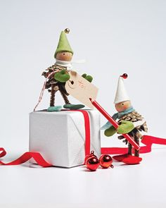 I'm so making these next year. Adorable pinecone elves, hats and all! It's quite tedious work though.