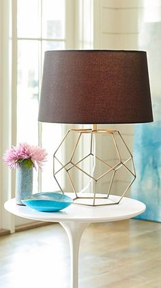 A lamp pretty much owns the space where it's placed, so try a clean, sculptural lamp like our Geo Wire Table Lamp to elevate the look of your lighting enough to carry the room.