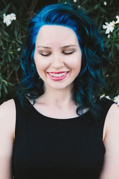 From Orange to Blue - How Did She Do? | Overtone Haircare  Gorgeous blue - love the pink lipstick!