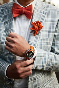 Orange bow tie, orange flower lapel and orange watch - great combination to spice up the afternoon!