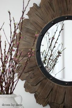 Round wood & iron mirror over foyer console