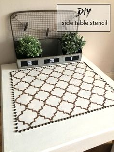 DIY side table refinish with stencilling and upholstery tacks!