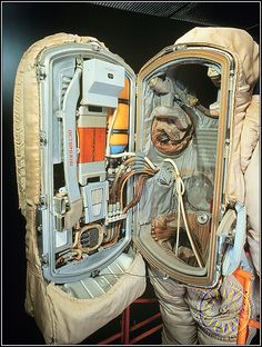 """Krechet (""""Golden Falcon"""") space suit developed in the 1960s by the Soviets for lunar exploration. Some of the differences from the Apollo suit: the backpack life-support unit is hinged like a door to allow entry; the torso is a semi-rigid shell; and the chest control panel folds up out of the way."""