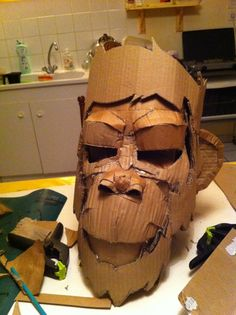search bing image for cardboard mask (art party).