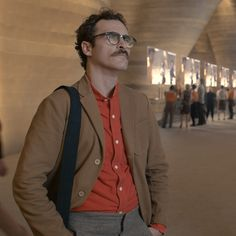 """Joaquin Phoenix in the film """"Her."""" I think the fashion in this movie was so successful because it presented futuristic fashion as slightly modified versions of what's successful today: muted colors, potent textures and interesting cuts."""