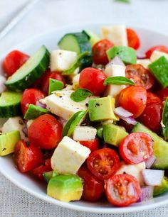 Tomatos, Cucumber, Avocados, Red Onion and Mozzarella Cheese tossed with a lovely balsamic and olive oil dressing. Simple, light, refreshing and healthy #cleaneating #tomatoes #happilyunprocessed