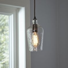 Add a stylish touch to your breakfast nook or kitchen with this industrial-chic pendant, featuring a hammered glass shade and oil-rubbed bronze finish.