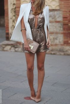 glam in gold sequin romper and a white cape