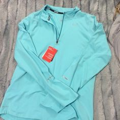 NWT Nike drifit quarterzip NWT Nike drifit quarterzip. Accidentally purchased men's small, but fits women's medium/large. Very cute Tiffany blue and can't tell its men's! Too large for me Nike Jackets & Coats